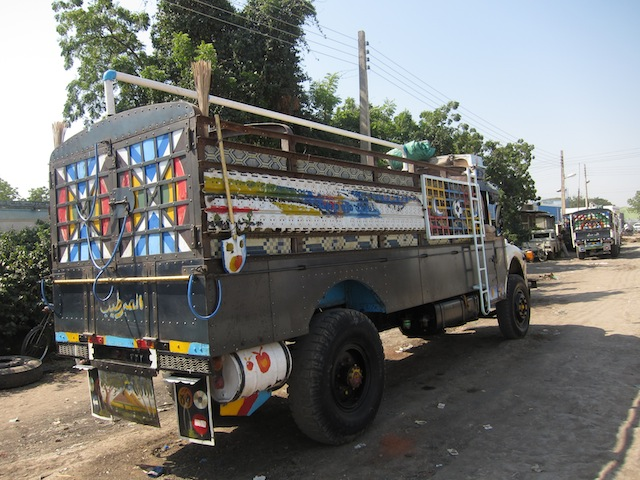 These trucks are used like semi trucks in Sudan. I thought they were circus trucks the way they are decorated!