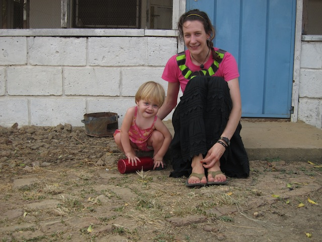 My niece, Avery, and me on the doorstep of my brother's home. We hung out here a lot watching the chickens. Good times.